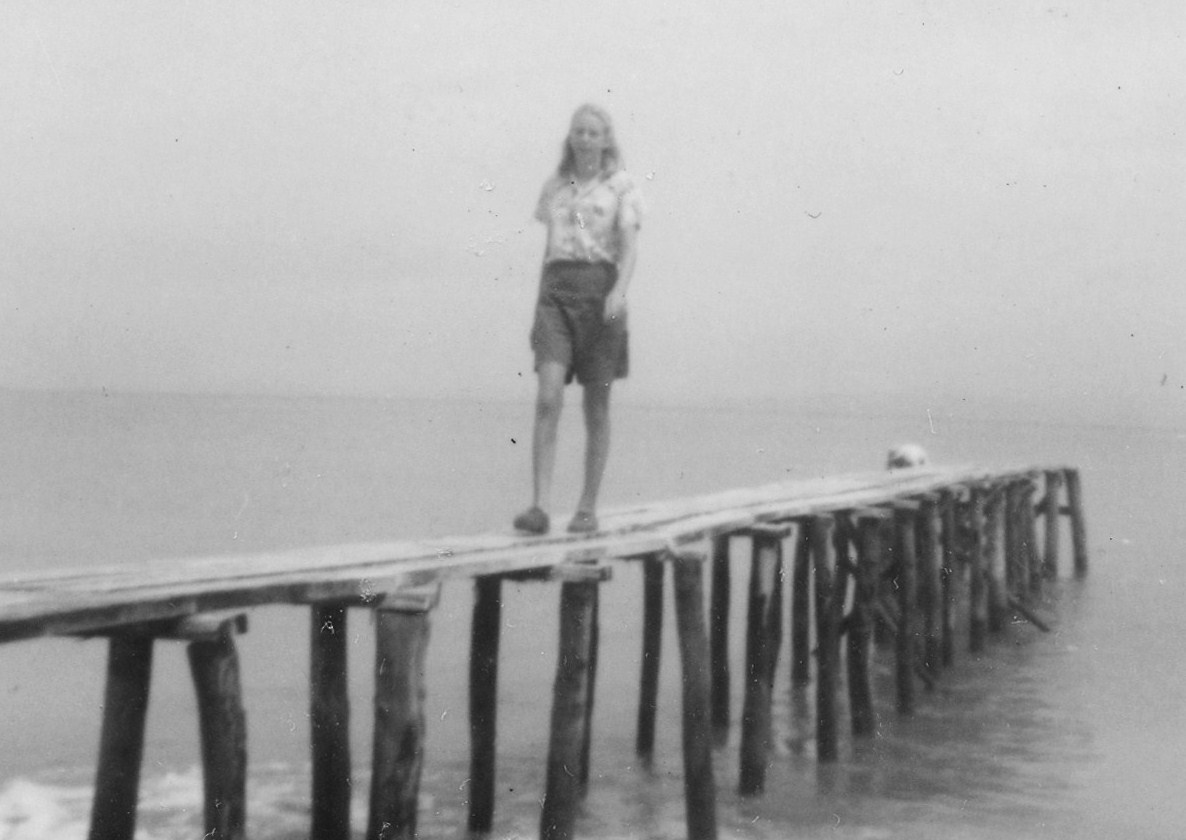 Berta on dock at Cocoloco beach (in 1950s)