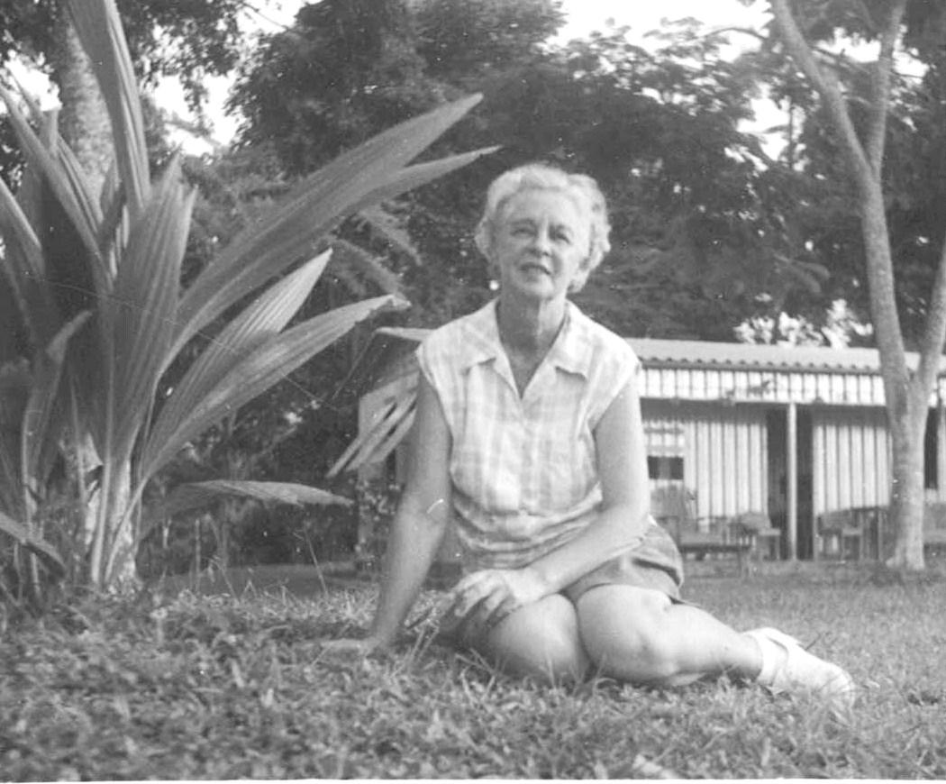Mama next to coconut seedling at Casalata
