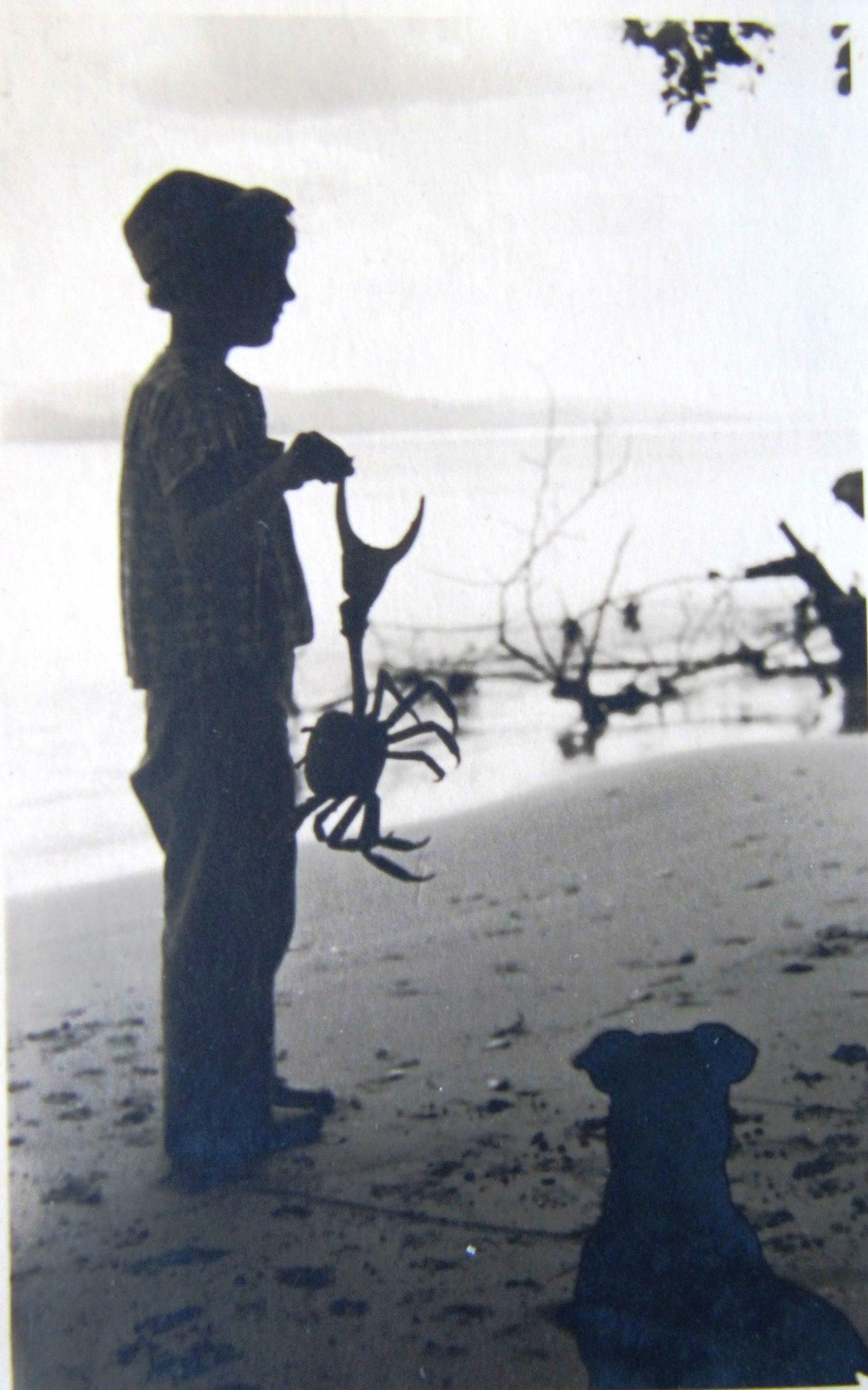 Old photo of Rita hold large crab (circa 1954)