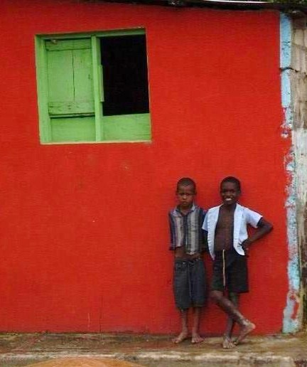 Boys and red house with green windows. Miches